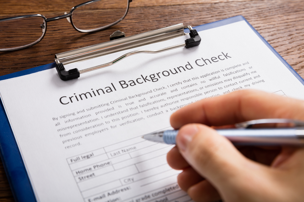What should be included in a pre-employment background check